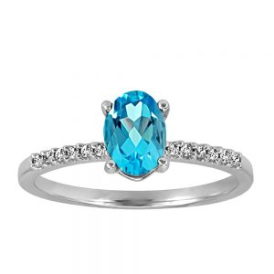 Ring with .07 Carat TW of Diamonds and Blue Topaz in 10kt White Gold